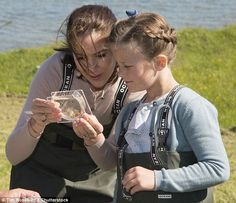 After the ship christening, Crown Princess Mary and Princess Isabella went off to another area of Samsoe Island to check out the local agriculture, where they observed a small fish in a test container before getting down to work
