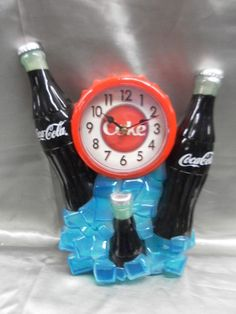 COCA COLA 3 BOTTLES AND ICE LIGHTED DECORATIVE WALL CLOCK