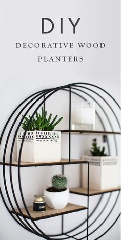 Bring some nature indoors this summer with some simple DIY planters. These decorative wood planters are the perfect way to display small flowers and succulents, and are sure to spruce up a shelf. All you need to create this home decor project is a bit of balsa wood, some wood glue, and black acrylic paint.
