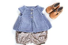 This charming cap-sleeved, swingycardigan is the perfect timeless piece to add to any little girl's summertime wardrobe, or as an extra layer in the Fall. Lovely over a crisp white dress, it isalso comfortable enough to be paired with everyday play clothes.The cables and seed stitch create a sophisticated, rich texture that is designed toshowcaseyarns with greatstitch definition.Construction: This cardigan is knit seamlessly from the top down. Stitches for the cap sleeves are bound off…