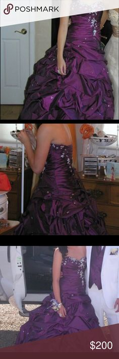 Royal purple ball gown - worn twice Beautiful purple gown with intricate jeweled detailing on the bodice and on the skirt. Corset on the back for flexibility in sizing. Originally $500. Dresses Prom