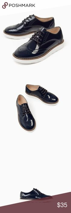 Zara size 11.5 Patent Cut Out Navy Bluchers Shoes New with Tags size 11  Brogue style with patent like finish and top stitching detail on the sole.They feature fabric lining,contrasting light soles and adjustable lacing. Great chic and trendy look for kids Girl or Boy Zara Shoes