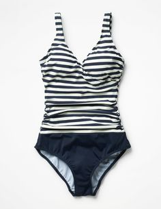 We took inspiration from our super-flattering wrap dresses to design this sleek swimsuit with a crossover neckline. Secret support and side ruching make it a Boden bestseller that you'd swim the Atlantic for.