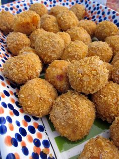 Buffalo Chicken Bites - cooked chicken, cream cheese, cheddar cheese and hot sauce coated with crushed corn flakes and baked - great for football watching parties! Can be frozen and baked later.