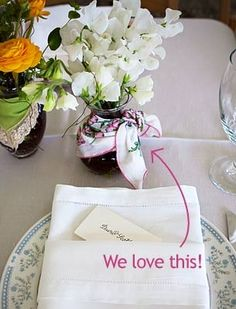 Vintage handkerchiefs tied around the vase