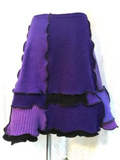 Sweater Skirt, Upcycled Sweater Skirt, Purple Plum Lavender Black with Serged Black Seams, Handcrafted from Recycled Wool Sweaters, Buttons and Pocket Accent, Medium to Large Women, Warm and Cozy  Waist 30 up to 38 (with a one inch elastic band) Hips: 40 Length 19-20  Hand wash or gentle cycle, lay flat to dry. Made from recycled wool sweaters found at my local non-profit outlet. After washing them in hot water and tumbling in the dryer for a felted-like feel, I cut them up and refashion the…