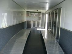 fully finished race ready enclosed trailer 32 ft triple axle. base cabinets overhead cabinets. ramps, winch