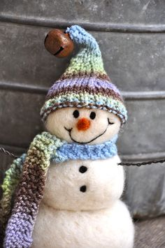 Needle Felted Snowman by Teresa Perleberg {I love the rusty jingle bell on the hat!}
