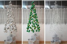 Christmas tree made from light bulbs suspended by clear threads and decorated boxes beneath for the support. DIYourselfer? I think so!