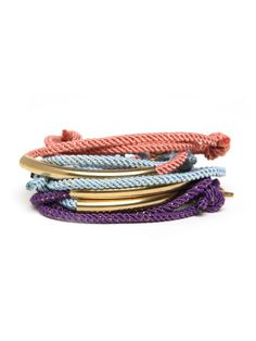 The bohemian wrap bracelet gets a shot of serious color in these bracelets. Crafted from textured rope in vivid sherbet colors, they each feature slim gold hardware for an additional boost of glamour.