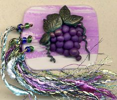 Sally White 2 1/4 x 1 3/4 ins marbled clay, modeled grapes and leaves, beads and fibres added to the jump rings