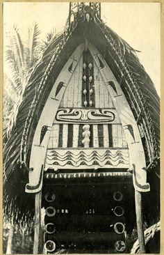 a yam house with a gable board decorated with painted designs and shells; Trobriand Islands.   Photographed by Raey Albert Goodyear Date 20thC(early)     Description Photograph (black and white); from an album;