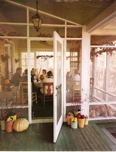 I love a screened porch.  What a sweet picture.
