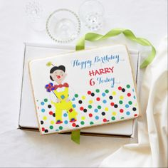 A fun and colorful personalized giant jumbo happy birthday cookie with a jolly circus clown, so cute and a favorite with young boys and girls alike; just customize it with your child's details or text of your choice.