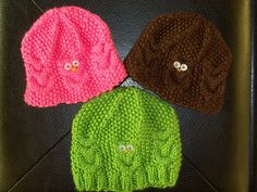 Owl baby hats knit by me.