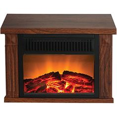 The Warm House Zurich Tabletop Retro Electric Fireplace - Medium Wood Print is a compact design that brings instant warmth to your living area,. Black Electric Fireplace, Electric Fireplaces, Best Space Heater, Tabletop Fireplaces, Indoor Fireplaces, Retro Table, Table Top Design, Fireplace Accessories, Home Decor Outlet