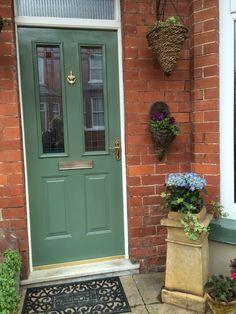 Farrow and ball Green smoke front door Farrow and ball Gree. Farrow and ball Green Front Doors, Exterior Front Doors, House Paint Exterior, Entry Doors, Entrance, Entryway, Front Door Planters, Front Door Porch, House Front Door