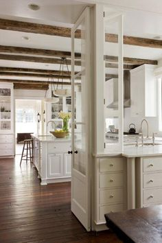 Make island as part of opening made in wall between original kitchen & dining room?  Maybe could make bigger opening if a support column was used like at end this island??