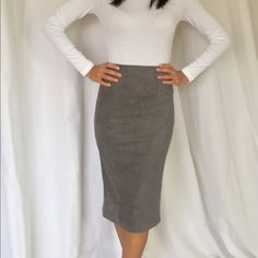 Gray suede skirt Beautiful gray suede pencil skirt very stretchy and stylish model is 5'4 and wearing a small Skirts Pencil