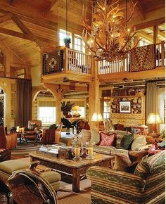 For my next home! Rustic log home living room. Terrific antler chandelier, and I love that sideboard