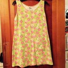 Lilly Pulitzer Shift Dress Cute shift dress with one pocket. The pattern has barely noticeable rhinos peaking out brhind flowers. Size medium. Gently worn with very slight fading from being washed. Nice dress! Lilly Pulitzer Dresses