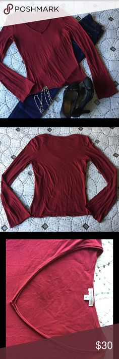 """🆕James Perse red long sleeve James Perse red long sleeve  🐾 Dark red long sleeve 🐾 V-neck 🐾 94% supima, 6% lycra 🐾 Length: 21"""" 🐾 Bust: 16"""" 🐾 Sleeve: 25 1/2"""" 🐾 Great condition  🐾 Bundle discount 10% off 2+ items 🐾 No trades, no PP James Perse Tops Tees - Long Sleeve"""