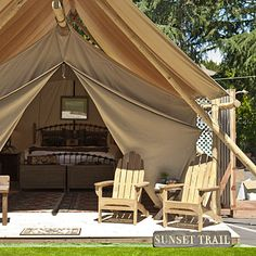 """Tent camping redefined: The Resort at Paws Up in Greenough, MT http://www.pawsup.com/ where """"roughing it"""" means canvas platform tents with oil paintings hanging above feather beds, terry-cloth robes as fluffy as Big Sky Country clouds,  elk-antler bedside lamps, and an outdoor porch."""