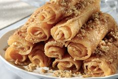 Diples Greek sweets with honey and walnuts Greek Sweets, Greek Desserts, Köstliche Desserts, Greek Recipes, Delicious Desserts, Yummy Food, Winter Desserts, Beignets, Greek Fries