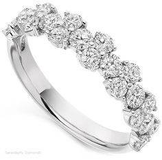 Probably the most beautiful diamond eternity rings. Absolutely stunning! I seriously doubt this would fit around my engagement ring but it sure is pretty!