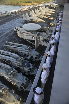 Sailors man the rails of the aircraft carrier USS Nimitz (CVN 68).
