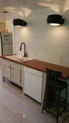 Kitchen Lighting Created Using Train Station Speakers, Custom Cabinet,  Butcher Block Countertops And White Shiplap.