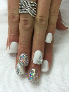 Rockn the Bling!! White, glitter & rhinestones rock out this awesome gel nail design!! All done with non-toxic and odorless gel.