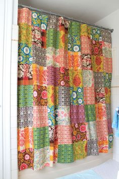 a patchwork shower curtain--what a fun idea...could do any colors or patterns to…