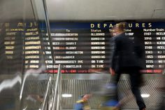 A sign announcing Amtrak and New Jersey Transit trains will be replaced by…