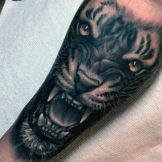 Tiger tattoo is getting popular in both man and woman. So here we will provide 101 tiger tattoo design that makes your identity unique and attrective. Mens Tiger Tattoo, Tiger Face Tattoo, Tiger Tattoo Sleeve, Sleeve Tattoos, Tattoos Arm Mann, Forarm Tattoos, Leg Tattoos, Xoil Tattoos, Octopus Tattoos