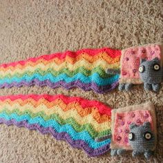 Facebook informed me that it's been five years since I made these Nyan Cat scarves and sent them to @joabeep in Korea. I was really into spooky button eyes at the time.  #nyancat #knit #crochet#caturday #timehop #poptarts #crocheteveryday #crochetgirlgang #sfmgsswoon #madeinarizona #handmadewithlove #korea #cats #kitty #rainbow #pride #allthecolors #internet #poptartcat #rainbowscarf #nyancatscarf #buttoneyes