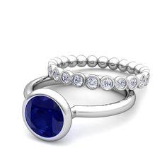 Bezel Set Blue Sapphire Ring and Diamond Wedding Ring Bridal Set in 14k Gold, 6mm. Elegant and simply radiant, this bridal set showcases a 6mm sapphire ring set in 14k gold with a matching diamond wedding band to complete the gorgeous look.