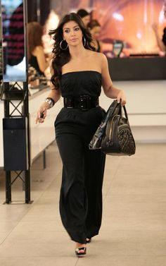 9ad47456024 Kim Kardashian wearing Black Halo Strapless Jumpsuit and Louis Vuitton Mizi  Vienna Bag.