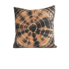 This gorgeous vintage tie-dyed geometric African Kuba raffia cloth pillow is backed in a coordinating tan linen. Small needle holes are sometimes visible from an original hand-sewn seam and close inspection often reveals hand-sewn seams and other subtle marks from its past life. #kuba #pillow #textile #artisan #Africa