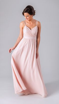 This long chiffon bridesmaid dress features an A-line skirt, ruched bodice, and elongating V-neckline.