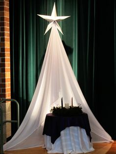 icu ~ Pin on Church ideas ~ Well THIS is quite different, creative and beautiful! Backed by a music stand with a PVC pipe sticking out of it. Christmas Stage Design, Church Christmas Decorations, Ward Christmas Party, Christmas Pageant, Christmas Program, Christmas Concert, Altar Decorations, Christmas Nativity, Christmas Tree