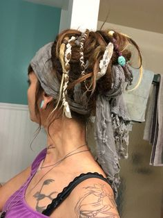 Dreadlock up-do with scarf and lace.