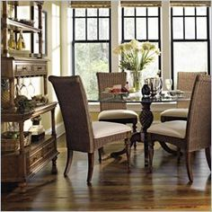 Dining Room With British Colonial Style Chairs And Pineapple Table.