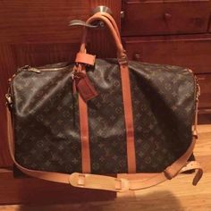 "SALE Authentic LV Keepall Bandouliere 55 Overall in EXCELLENT condition with minor water marks as pictured. No rips, No stains. Leather has turned a nice golden patina. Inside is in great condition with no major damage. Comes with monogram id tag, luggage loop, strap & lock & key! Because of posh fees I am firm on the price listed!   Date Code: TH0995 | Handles: 12.99 (33cm) Strap: 39.37"" - 47.24"" (100cm - 120cm).   Includes the ""Vachetta Cleanser"" from Lovin My Bags"