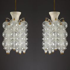 Pair of lacquered iron chandelier, each chandelier with ten columns of bubble glass designed in the 1960s in Venini taste.