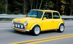 Most popular tags for this image include: car, classic, mini, vintage and yellow