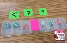Dice in pill containers for comparing numbers, place value, addition and subtraction. Lots of game ideas.