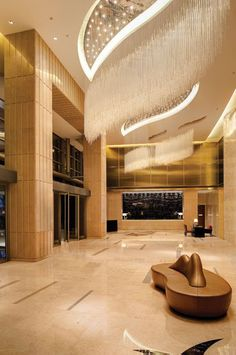 """""""He left me at my hotel at 3:00 AM, murmuring: You're marvelous""""- ANAÏS NIN - (Sublime lobby of the Kempinski Hotel Yinchuan: it features two custom - designed crystal chandeliers that resemble rain showers)"""