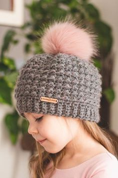 The Jasmin Hat. Such a cool free pattern! That pink pompom is awesome!
