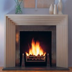 The Odeon Fireplace from Chesneys (but not using the mantle... having black lacquer wood panel flush to the metal insert)